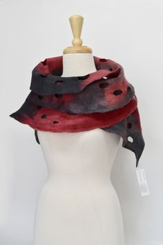 This classic Red and Black Merino Wool Felted Scarf in beautiful warm hand dyed super soft next to skin 18.5 micron hand dyed Australian Merino wool.      Approx size down the centre of the scarf. Length 160 cm approx. Width 24 cm approx across the widest part Super fine Australian Merino wool