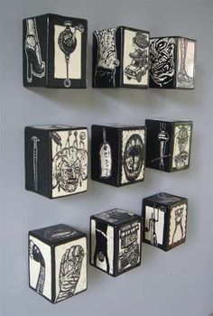 Clay wall boxes with a sgraffito finish.