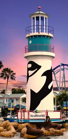 Sea World Lighthouse, Orlando, FL. May the orcas on the light house someday  represent freedom for the great mammals of the oceans!
