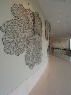 large wire leaves as a graphic element.  Maybe at cash-wrap or on stair-wall....  would take forever to do but the lines are really beautiful.