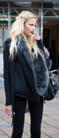 Umm...  I just love her lip color. And as usual, the great fur sole, jacket, and dark blue skinnies.
