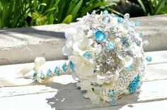 Create your own brooch bouquet for your wedding as a memorable piece - try using silk flowers as well as pins & brooches of all sizes to make it look amazing...start with wrapping wire around each piece you have and finish it off with covering it with corsage tape then bunch them all together how ever you wish your bouquet to look & wrap more courage tape around stem finishing off with your chosen ribbon. Done