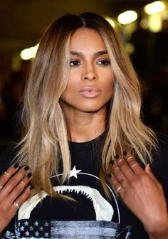 Ciara with dark roots with honey blonde, light golden blonde and a hint of platinum blonde low lights in front. I would love to do this look for myself.