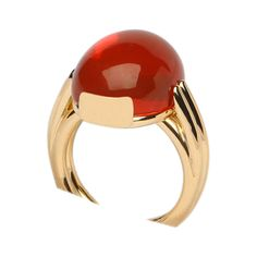 A bold contemporary fire opal ring. An intense orange fire opal is the center of this handmade contemporary ring. Simple bold style