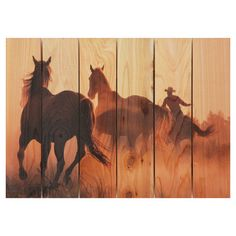 "Round Up Wall Art  Red cedar wall art with a galloping horse and rancher motif. Ink on western red cedar Small: 16"" H x 22.5"" W Large: 24"" H x 33"" W $55.95"
