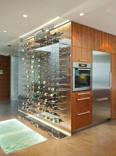 #Sleek & #modern #kitchen #design with built-in #wine #bottle #display. Love this #idea and that super cool floor!