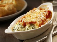 Ricotta Spinach Manicotti - Manicotti is an easy and elegant dish to add to your foodie repertoire. With these simple instructions, this stuffed pasta's creamy and fresh flavors are sure to satisfy.