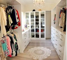 Beautiful walk in closet for a master bedroom. big, but not too big. white and bright and light. I wish.