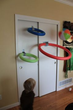 Indoor basketball hoops using pool noodles and beach balls.