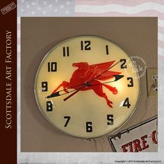 Genuine Mobil Gas vintage Pam clock with light, circa 1940s-1970s - this one is more 50s featuring the Mobil Gas red Pegasus logo.