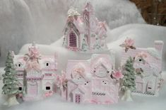 Shabby Chic Christmas Village houses done in soft pink and white with glass glitter, roses, trims and much more.