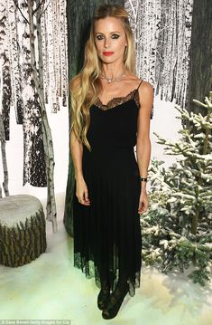 Still got it:The 44-year-old blonde dazzled in a sexy black slip dress with a delicate lace trim