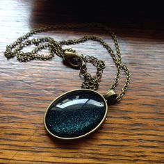 Coming straight from Davy Jones' locker to you! If you're into dark sparkles, you need this pendant. It's subtle but filled with shine.
