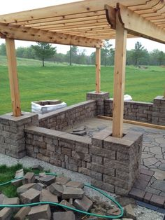 Combination seating wall, patio and pergola.