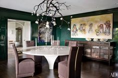 This Greenwich, Connecticut, dining room includes a Christophe Côme sideboard from Cristina Grajales Gallery that stands beneath a Richard Prince canvas; Joe Nahem of the design firm Fox-Nahem Assoc. updated the home.