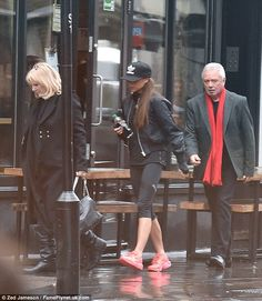 Hungry? Victoria Beckham headed out in rainy London on Tuesday to grab a burger with her p...