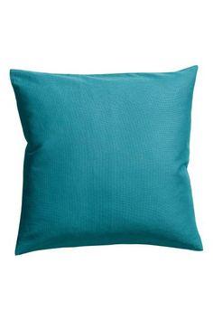 Poszewka na poduszkę z bawełnianego płótna. Kryty suwak.