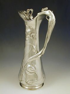 yama-bato: Polished pewter flagon with a handle in the form of a figural art nouveau mermaid,  Germany Date c.1906