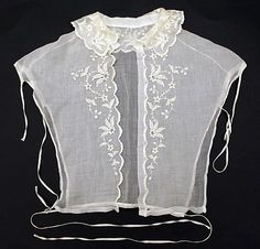"""1850-1869, the kind of lace collar--what we might call a """"dickey""""--that would be worn with an 1850s dress along with similarly light lace undersleeves. In addition to adding a decorative touch, these pieces kept the main bodice from being soiled at key places...important in a day when there was really no way to fully clean, say, a wool dress."""