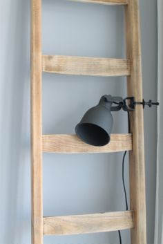 vintage pine ladder dusted sky blue walls and matt grey lamp