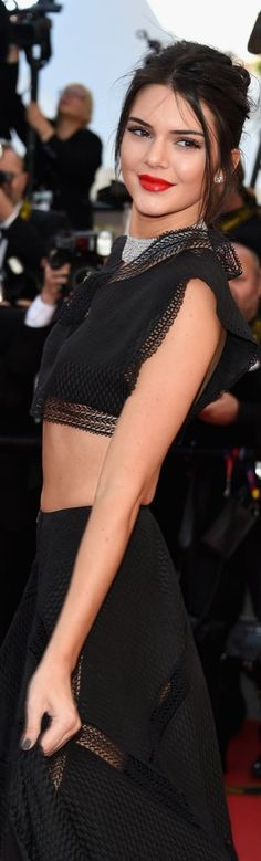 Kendall Jenner wore a black feminine-meets-gothic Azzedine Alaïa crop top and skirt at the premiere of Youth at Cannes. She completed her look with a diamond choker, matching bracelet, and complementing stud earrings.