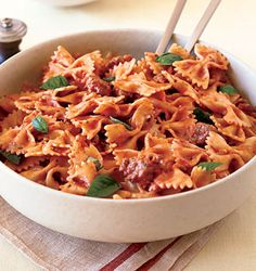 """This recipe for Farfalle with Sausage, Tomatoes, and Cream is from Epicurious.com. Ive been making it for years--family favorite, guest favorite. I have one adjustment to the recipe: use diced tomatoes in juice not crushed for a less """"sauce"""" feel. Also, can def be used with chicken sausage rather than pork."""