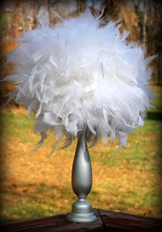 """Feather centerpiece (simple DIY - base, styrofoam ball, boa - adjust colors for event - """"Denim and Diamonds,"""" """"Black and Bling,"""" """"Dimes and Diamonds."""")"""