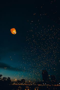 Floating lanterns filling the night sky Floating Lanterns, Sky Lanterns, Paper Lanterns, Lantern Lighting, Beautiful World, Beautiful Places, Beautiful Pictures, Dream Images, You're Beautiful