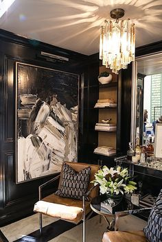 A dramatic painting by Ricardo Rumi showed how art can make a space sing. This dark sexy vignette was instantly inviting with glossy black walls and a glamorous mix of modern mid-century pieces with very traditional elements. A rare two toned Murano glass chandelier from AWK Antiques topping the space with sparkling style. | Designed by Christina Roughan