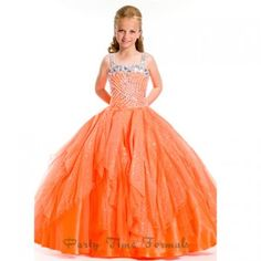 A beautiful pageant gown for your toddler or little girl by Party Time Formals. Long heavily beaded little girls ball gown with large crystal beading along chest and straps. Soft sparkling tulle with a zip up back. This gown will make her feel like a prin