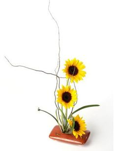 Sunflowers and some branches make up this simple design.  Sometimes less is more :)