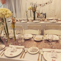 Rose gold, peach and pink bridal shower...in a garage! Cover the walls with plastic sheeting.
