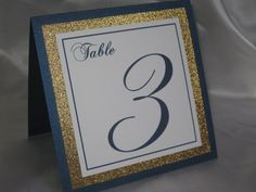 Style #304 - Navy Shimmer, Gold Glitter & White Tented Wedding Table Numbers    Simplicity! This shimmer matted table card is printed on a heavy