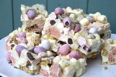 Mini Egg Rocky Road Colourful and decadent white chocolate rocky road bars filled with fruity marshmallows, crunchy digestive and wafer pink biscuits and mini chocolate eggs.