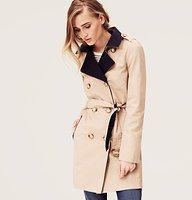 "Colorblock Cotton Twill Trench Coat - Thoughtful colorblocking elevates this smart twill trench with style—and modernity. Collared. Long sleeves. Epaulettes. Double breasted button front. Front and back storm flaps. Belted waist with belt loops and buckle closure. Flap pockets. Vented details at back. Lined. 33"" long."