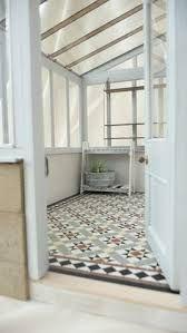 Lean to conservatory with traditional Edwardian encaustic tiled floor. - Lean to conservatory with traditional Edwardian encaustic tiled floor. Conservatory Flooring, Lean To Conservatory, Conservatory Interiors, Conservatory Decor, Diy Kitchen, Kitchen Design, Kitchen Ideas, Kitchen Tile, Room Kitchen