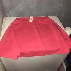 Coral Skater Skirt A lovely spring item! This should be in your closet...a size 1 (14/16) coral textured skater skirt from Torrid. This item is new with tags and is waiting to become a part of your wardrobe. torrid Skirts Circle & Skater