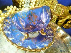 FAN CREST JAPAN TEA CUP AND SAUCER PURPLE & MOTHER OF PEARL HONEYCOMB SHAPE