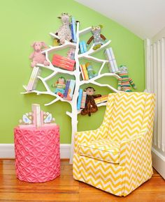 Decorating Ideas for Fun Playrooms and Kids' Bedrooms : Who says books don't grow on trees? This story-time corner cleverly uses vertical space to display toys and boys. Design by Susie Fougerousse. From DIYnetwork.com