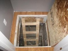 Trap door in wooden floor - The hinges are visible, but throw a ...