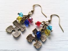 Puzzle Piece Earrings, Antiqued brass Autism Awareness earrings, puzzle piece charms, pierced ears, woman's earrings, awareness jewelry on Etsy, $14.00