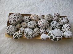 Crochet covered river rocks - must learn how to do this!  door stop, dress pattern weight, gift...