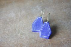 That unmistakable crisp blue of dreamy Greek-island villages can be a part of your everyday life, thanks to these simple geometric earrings (made in, er, Belgium). #etsy