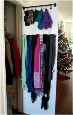 10 Awesome Ideas to Store and Organize Your Clothes: Fix a Towel Rod on the Back of Your Coat Closet for Hanging Scarves