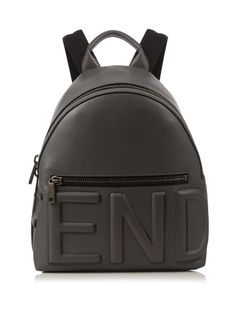 Fendi's cement-grey backpack will add a sports-luxe finish to new-season looks. The lightly-grained calf-leather is constructed to a sleek silhouette, features a bold embossed logo at the front and sides, and is finished with matte gunmetal hardware. | Available at MATCHESFASHION.COM