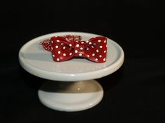 Polymer clay bow - red with white polka dots.