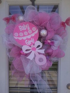 Its a Girl Wreath-Deco Mesh with Bottle and Ribbon, Pacifiers, and Pink Butterflies. $60.00, via Etsy.