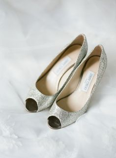 Classic silver Jimmy Choos: http://www.stylemepretty.com/2014/09/29/modern-white-loft-wedding-at-studio-450/ | Photography: Lindsay Madden - http://www.lindsaymaddenphotography.com/