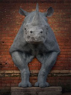 UK-based artist Kendra Haste creates awesomely lifelike - and often life-size - animals sculpture using only numerous layers of painted, galvanized wire shaped atop a steel armature. Art Sculpture, Animal Sculptures, Wire Sculptures, Victorian Bulldog, Chicken Wire Art, Royal College Of Art, Rhinoceros, Large Animals, Wild Animals