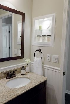 Remove medicine cabinet.   Install beadboard on back, sides, top, and bottom.   Finish with trim molding.   Paint.   Totally doing this in kids' bath!